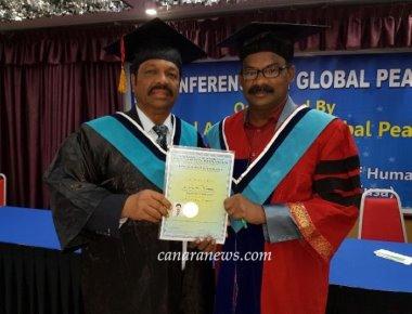 Mangalorean Dr. Devid Frank Fernandes Thottam Honouyred with Hon. Ambassador  Lt. Gen. Commander M. E. Chancellor