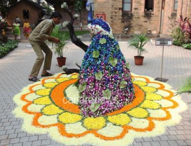 BMC gardner making peacock effigy from various colourful of flowers at BMC head quarter