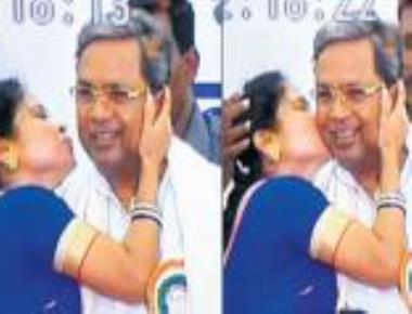 Siddaramaiah blushes as young woman kisses him in public