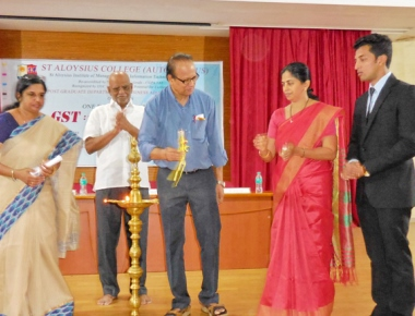 Symposium on GST inaugurated at AIMIT