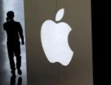 Apple posts annual earnings of $53.4 bn
