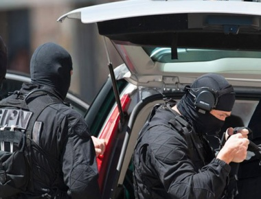 Gun battle breaks out in Paris during anti-terror raids; suspects holed up in an apartment