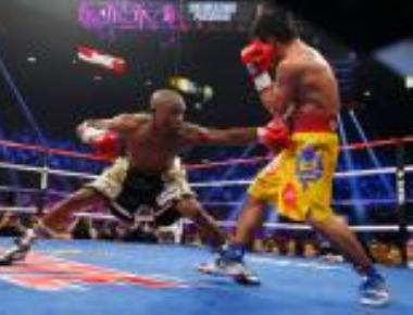 Mayweather beats Pacquiao to unify welterweight titles