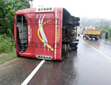 20 injured as bus hits soil mound and falls on its side