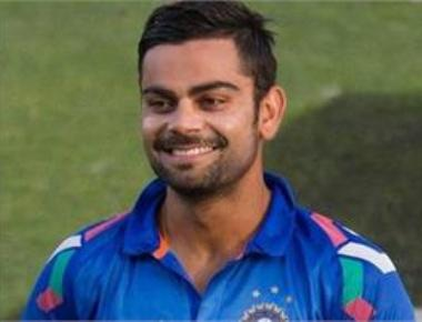 Kohli keeps wickets to give Dhoni a one-over break