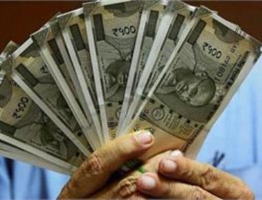 Rupee ends flat at 66.66 a dollar; all eyes on FOMC outcome