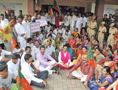 BJP stages protest against George