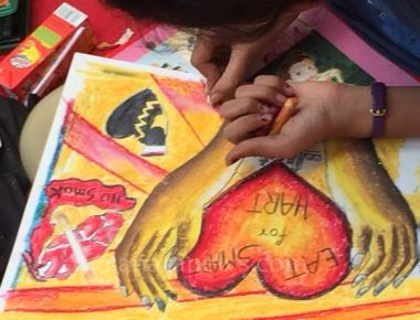 World Heart Day - A Drawing by children's giving massage to people on the day
