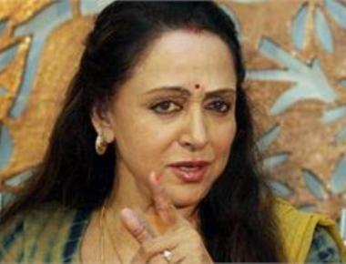 Haven't grabbed land, will follow govt rules: Hema Malini