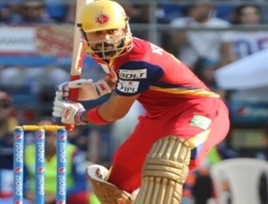 Kohli, Gayle help RCB climb second on the table