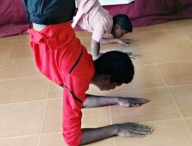 Koraga boys step up onto yoga stage