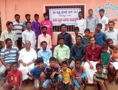 Krishna Friends Club, Malali distributes books to school children