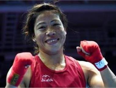 Mary Kom strikes gold; Cuba, Uzbekistan halt men