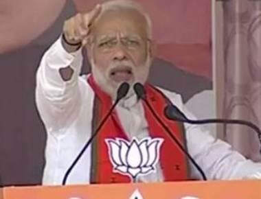 Modi attacks Rahul, Sonia over demonetisation