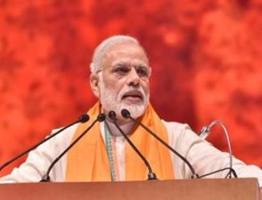 Modi blasts opposition for 'dividing' the country