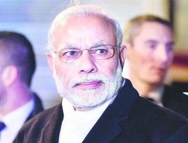 PM plans Christmas party 'drop-in'- Modi to try and polish image at tea hosted by Jaitley for Christian leaders