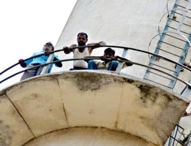 Mysugar workers scale chimney, demand pending salary