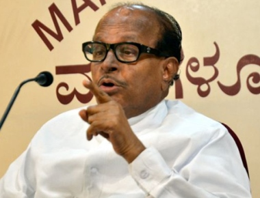 Poojary blasts CM and PM for farmers suicide