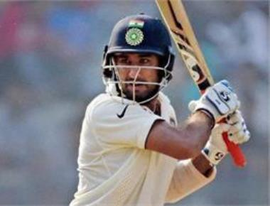 Vijay, Pujara shine after India bowl England out for 400