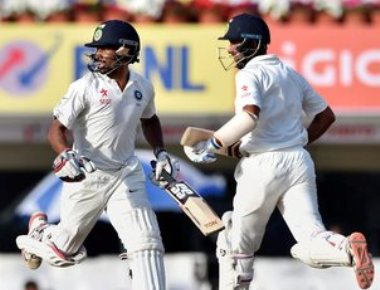 Pujara's ability to soak in pressure makes it easy: Vijay