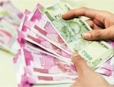 Rupee declines 11 paise to close at 73.27 against US dollar