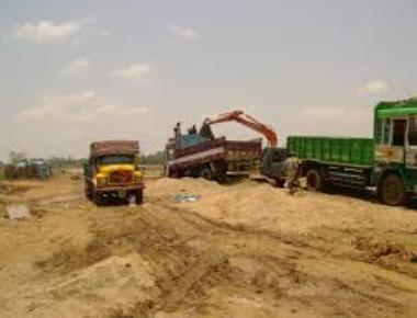 Illegal truck loaded with sand held