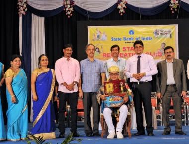 SBI felicitates state film award winning actor Naveen D Padil