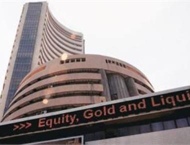 Sensex rallies over 300 pts; Nifty breaches 11,200 mark
