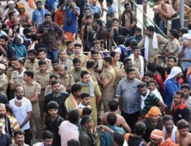 High drama at Sabarimala as frenzied protesters try to block woman; TV cameraman injured
