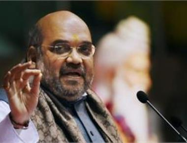 Shah challenges Cong to open debate on development