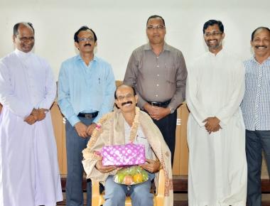 Felicitation to Prof. P Janardhana Herle at St Philomena College Puttur