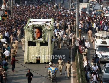 People gather in large number to pay their respect during the funeral procession of actor Sridevi in Mumbai on Wednesday.