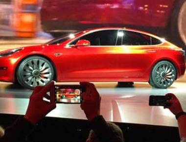 First Tesla Model 3 electric car rolling off production line