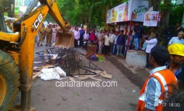 TMC Demolished all illegal hawkers who had encroached the Hiranandani Meadows and Lokpuram area .