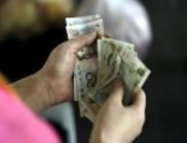 China sets yuan rate at four-year low against dollar